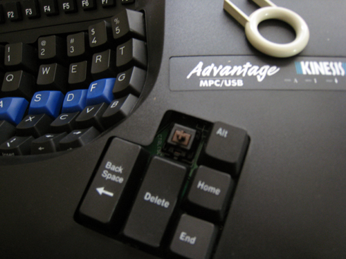 The tool used to remove keycaps is at the upper right; putting Mac-labeled keys on was easy.